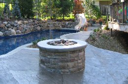 Add a Poolscapes fire pit or fireplace to your inground pool